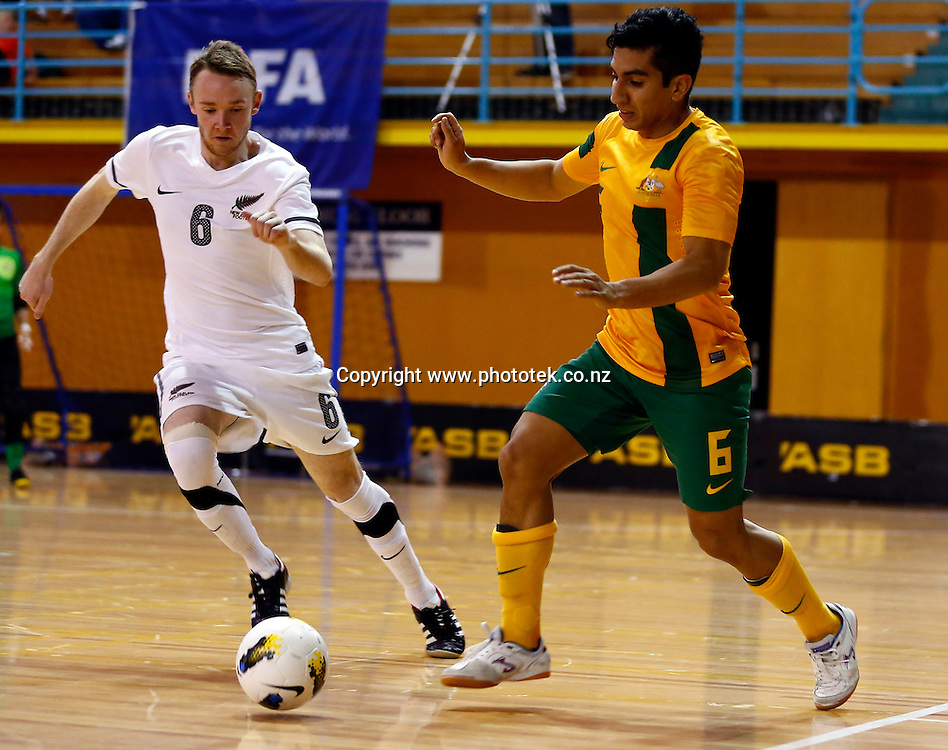 Futsal Roos Andreas Gomez gets the edge on Futsal Whites Michael Sannum. ASB Trans Tasman Cup, Futsal Whites v Futsal Roos, ASB Stadium, Kohimarama, Sunday 23rd September 2012. Photo: Shane Wenzlick