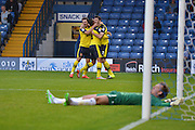 Conor McLaughlin celebrates his equaliser after leaving bury goalkeeper Christian Walton stranded during the Sky Bet League 1 match between Bury and Fleetwood Town at Gigg Lane, Bury, England on 18 August 2015. Photo by Mark Pollitt.