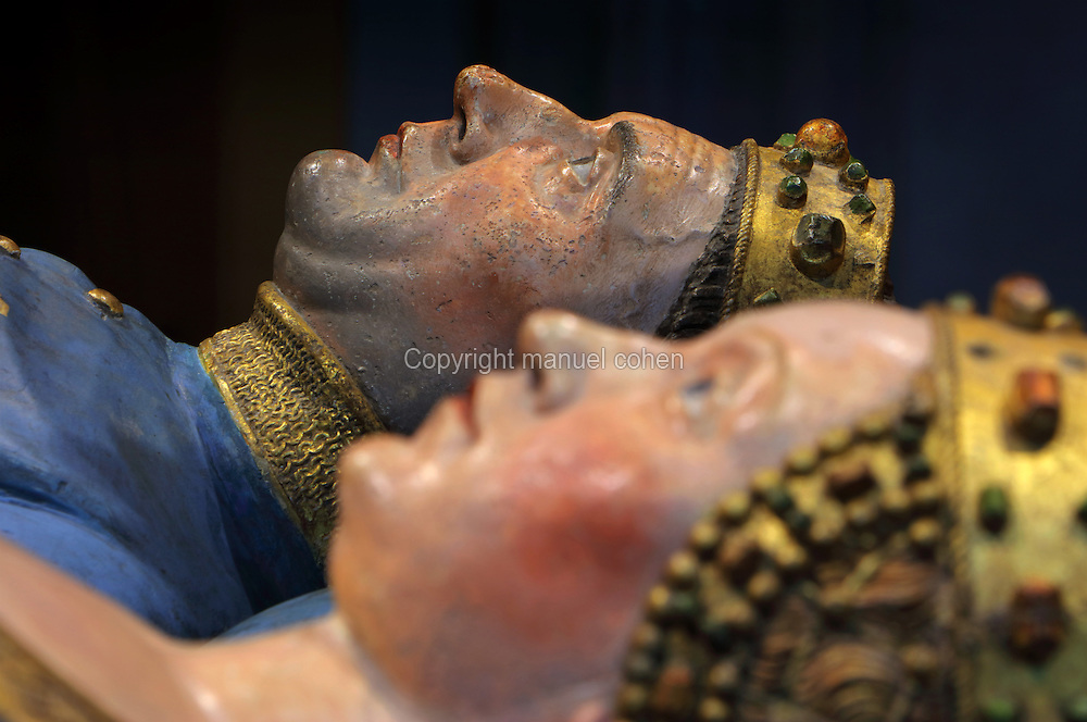 Effigies from the tomb of Jean sans Peur, or John the Fearless, 1371-1419, (Jean de Valois or John of Valois, Jean I, duc de Bourgogne, or John I, Duke of Burgundy) and his wife Marguerite de Baviere, or Margaret of Bavaria, 1363- 1423, 1443-70, by Jean de la Huerta, 1413-62, and Antoine le Moiturier, 1425-97, in the Grande Salle du Palais des ducs de Bourgogne, or Salle des Gardes, a 15th century Flamboyant Gothic hall, in the Musee des Beaux-Arts de Dijon, opened 1787 in the Palace of the Dukes of Burgundy in Dijon, Burgundy, France. The tomb consists of painted alabaster effigies with lions and angels, and below, figures of pleurants or weepers among Gothic tracery. The tomb was begun in 1443 (24 years after his death), by Jean de La Huerta, and Antoine le Moiturier after 1456, and finally installed in 1470. The tombs were originally from the Chartreuse de Champmol, or Chartreuse de la Sainte-Trinite de Champmol, a Carthusian monastery which was sacked in the French Revolution and the tombs moved to Dijon cathedral then here in 1827. The effigies are 19th century reconstructions, the originals being destroyed in the French Revolution. Picture by Manuel Cohen