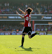 Jota celebrating scoring in injury time during the Sky Bet Championship match between Brentford and Nottingham Forest at Griffin Park, London, England on 6 April 2015. Photo by Matthew Redman.