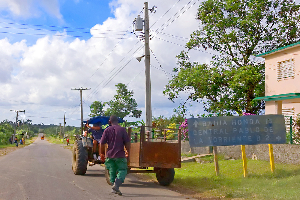 Tractor and road sign near Cabanas, Artemisa, Cuba.