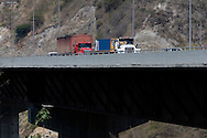 Trucks passing across the venezuelan major bridge called viaduct #1. This bridge is the key route to the country's main airport in Venezuela. Feb 27 2008. (ivan gonzalez).