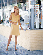Photograph of fashion model in a cute sundress, enjoying her icecream at the corner store. This image was captured for Boston Proper.