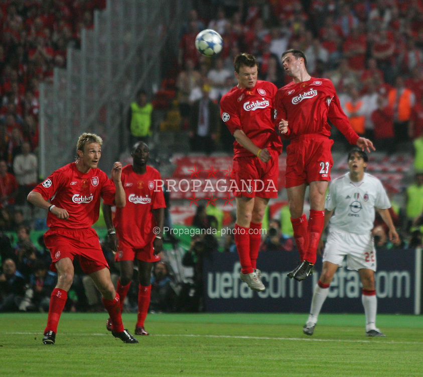 ISTANBUL, TURKEY - WEDNESDAY, MAY 25th, 2005: Liverpool's John Arne Riise and Jamie Carragher both rise to head clear the ball against AC Milan during the UEFA Champions League Final at the Ataturk Olympic Stadium, Istanbul. (Pic by David Rawcliffe/Propaganda)