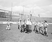 Children and workers go for the slitor mid air during their visit to Croke Park during a Kells Educational Tour on the 25th June 1976.