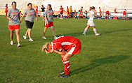 29 MAY 2010 -- FENTON, Mo. -- Incarnate Word Academy's Sarah Doggendorf (5) pauses on the field after Cor Jesu Academy beat the defending state champs 1-0 in overtime during the MSHSAA Class 3 girls' soccer quarterfinal at the A-B Center in Fenton, Mo. Saturday, May 29, 2010. Coaches from Cor Jesu, including head coach Melissa Bruno (far left) walk to console and congratulate Doggendorf. Photo © copyright 2010 by Sid Hastings.