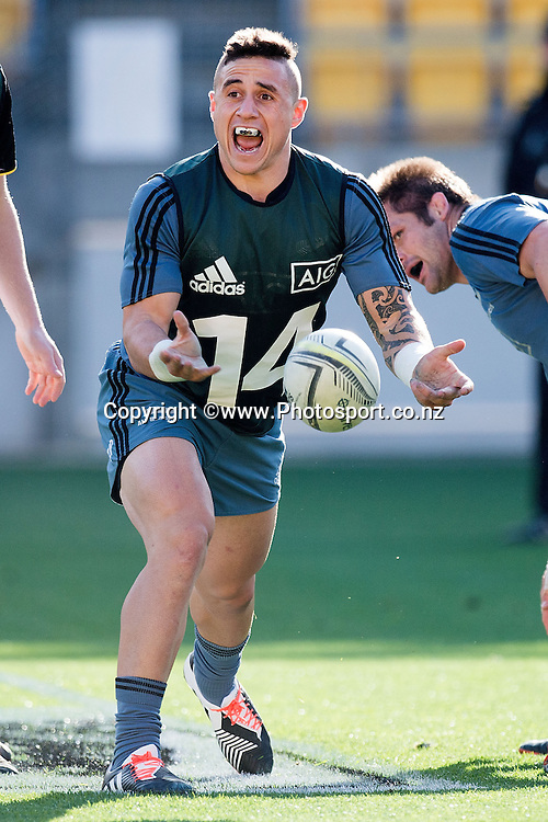 TJ Perenara of the All Blacks watches makes a pass during a All Blacks Training session at the Westpac Stadium in Wellington on Thursday the 11th of September 2014. Photo by Marty Melville/www.Photosport.co.nz