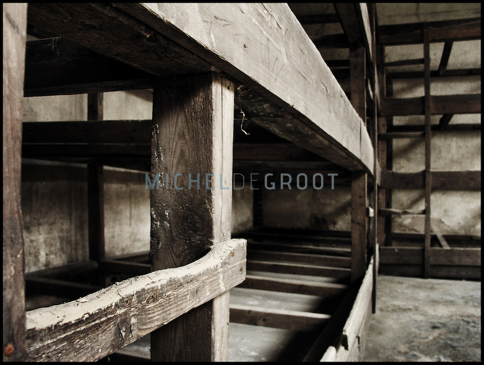 """Battery beds in the Jewish getto at the small fortress of Terezin, located fourthy miles north of Prague, Czech Republic on May 8, 2003. The town was originally built in 1780 by Emperor Joseph II of Austria and named after his mother, Empress Maria Theresa and consisted of the Big Fortress and the Small Fortress. Terezin changed dramatically when the Nazis renamed it Theresienstadt and sent the first Jewish transports there in November 1941. The Nazis chose the 18th century fortress at Terezin to be a """"model ghetto,"""" The largest and most serious problem they faced was metamorphosing a town which in 1940 held approximately 7,000 residents into a concentration camp which needed to hold about 35,000 to 60,000. Some 33,000 Jews died here under the Nazis; another 88,000 were deported to extermination camps and murdered."""