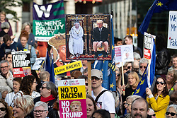 © Licensed to London News Pictures . 03/06/2019. Manchester, UK. A placard depicting the Queen and Donald Trump sitting on a throne and a toilet respectively . A Manchester Together Against Trump demonstration in Cathedral Gardens , central Manchester , during the first day of US President Donald Trump's visit to the UK . Photo credit: Joel Goodman/LNP