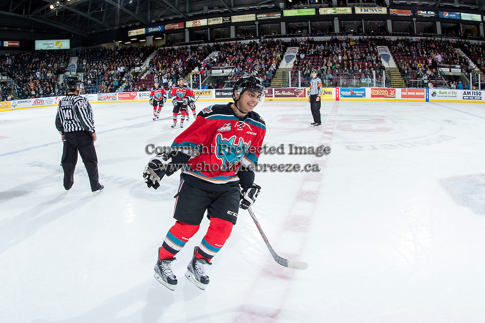 KELOWNA, CANADA - OCTOBER 31: Nick Merkley #10 of the Kelowna Rockets skates to the bench to celebrate a first period goal against the Lethbridge Hurricanes on October 31, 2015 at Prospera Place in Kelowna, British Columbia, Canada.  (Photo by Marissa Baecker/Shoot the Breeze)  *** Local Caption *** Nick Merkley