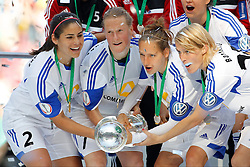 17.05.2014, Rhein-Energie Stadion, Koeln, GER, DFB Pokal, Frauen, 1. FFC Frankfurt vs SGS Essen, Finale, im Bild vl: Alina Garciamendez (1. FFC Frankfurt #2), Melanie Behringer (1. FFC Frankfurt #7), Babett Peter (1. FFC Frankfurt #4) und Saskia Barusiak (1. FFC Frankfurt #25) mit dem Pokal<br /> <br /> 1. FFC Frankfurt vs SGS Essen --- Frauen Fussball --- DFB Pokal Finale --- 17.05.2014, Foto: Eibner // during the woman DFB Pokal final match between 1. FFC Frankfurt and SGS Essen at the Rhein-Energie Stadion in Koeln, Germany on 2014/05/17. EXPA Pictures © 2014, PhotoCredit: EXPA/ Eibner-Pressefoto/ Schueler<br /> <br /> *****ATTENTION - OUT of GER*****