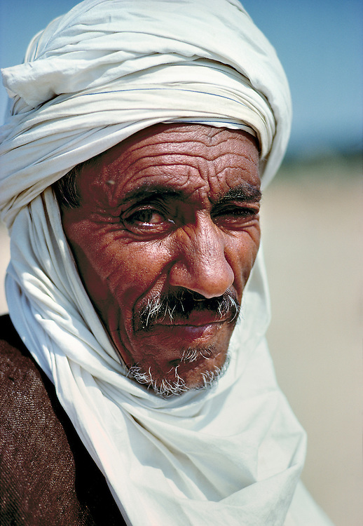 A local man casts a wary eye at the camera near Nefta in Tunisia.
