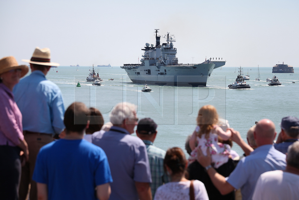 © Licensed to London News Pictures. 22/07/2014. Portsmouth, Hampshire, UK. The Royal Navy's helicopter carrier, HMS Illustrious, sails into her homeport of Portsmouth for the final time before a decommissioning ceremony later this year. The former aircraft carrier, nicknamed 'Lusty', is the last of the Invincible Class carriers, and will be retired after 32 years of active service and replaced by the recently refitted HMS Ocean. Photo credit : Rob Arnold/LNP