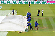 The groundstaff rolling up the covers on the wicket as the rain stops with and inspection due at 11:40am during the International Test Match 2019 match between England and Australia at Lord's Cricket Ground, St John's Wood, United Kingdom on 18 August 2019.