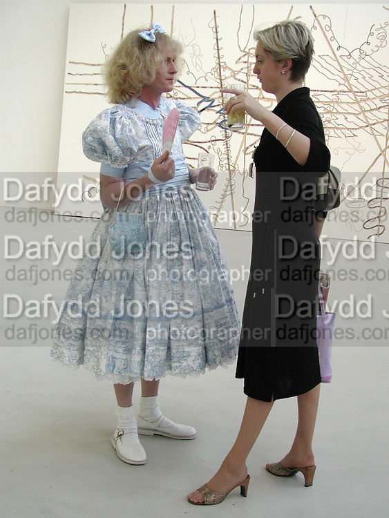 GRAYSON PERRY; JULES DIXON, Grace Perry and Jules Dixon. Saatchi Gallery reception. 29 May 2001. © Copyright Photograph by Dafydd Jones 66 Stockwell Park Rd. London SW9 0DA Tel 020 7733 0108 www.dafjones.com