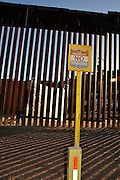 A sign in Nogales, Arizona, warns that entering the property along the US and Mexico border at Nogales, Sonora, is trespassing.