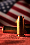 Undischarged rounds from guns with an American flag.