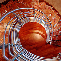 A spiral staircase in a multi-million dollar condominium overlooking Petco Park in San Diego, California.