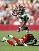 SAN FRANCISCO - SEPTEMBER 17:  Running back Steven Jackson #39 of the St. Louis Rams goes airborne and dives over a defender for some of his 103 yards on 22 carries against the San Francisco 49ers at Monster Park on September 17, 2006 in San Francisco, California. The Niners defeated the Rams 20-13. ©Paul Anthony Spinelli *** Local Caption *** Steven Jackson