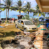 Crashed Car and Destroyed Hotel After Tsunami on Patong Beach in Phuket, Thailand<br />