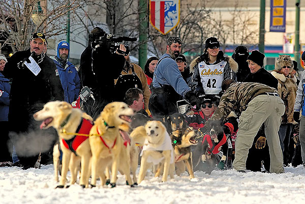 04 March 2006: Anchorage, Alaska - Rachel Scdoris of Bend Ore. is mobbed by media and fans at the start line of the Ceremonial Start in downtown Anchorage of the 2006 Iditarod Sled Dog Race.