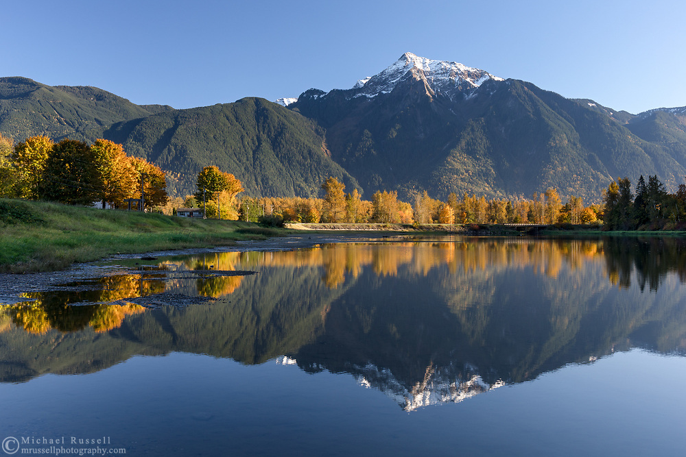 Mount Cheam is reflected in the waters of Maria Slough on Seabird Island, Agassiz, British Columbia, Canada