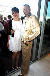 DAISY LOWE and fashion designer JOE CORRE son of Vivienne Westwood at a party to celebrate the publication of 'All That Glitters' by Pearl Lowe held at the May Fair Hotel, London on 8th July 2007.<br />