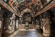 Frescoes, 9th - 11th century, in Karabas Kilise, or the Black Head Church (as the painted figures have been blackened by smoke from oil lamps), in the Soganli Valley in Goreme, in Nevsehir province, Cappadocia, Central Anatolia, Turkey. The churches in Goreme are carved from the soft volcanic tuff created by ash from volcanic eruptions millions of years ago. Early christians came here to flee persecution by the Romans and others settled here under the influence of early saints. This area forms part of the Goreme National Park and the Rock Sites of Cappadocia UNESCO World Heritage Site. Picture by Manuel Cohen