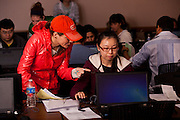 Student volunteer Lindsey Marginian (Left) assists international student Xiumin Jin of China complete her tax forms at a volunteer income tax assesment program offered by the College of Business at Ohio University.
