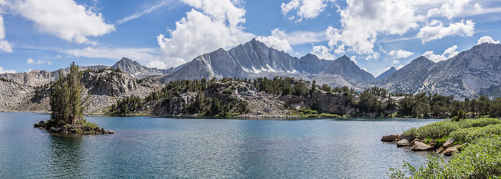Mount Goode (13,085 feet) rises above Ruwau Lake in John Muir Wilderness, Inyo National Forest, Sierra Nevada, California, USA. My favorite hike in the Bishop Creek watershed goes from South Lake to Long Lake and Saddlerock Lake, looping back via a steeper, poorly marked route to Ruwau Lake, Chocolate Lakes, and Bull Lake. The rewarding semi-loop is 9 miles with 2220 feet cumulative gain. An easier walk is 7.2 miles round trip with 1500 feet gain to Saddlerock Lake, out and back via beautiful Long Lake. This panorama was stitched from 3 overlapping photos.
