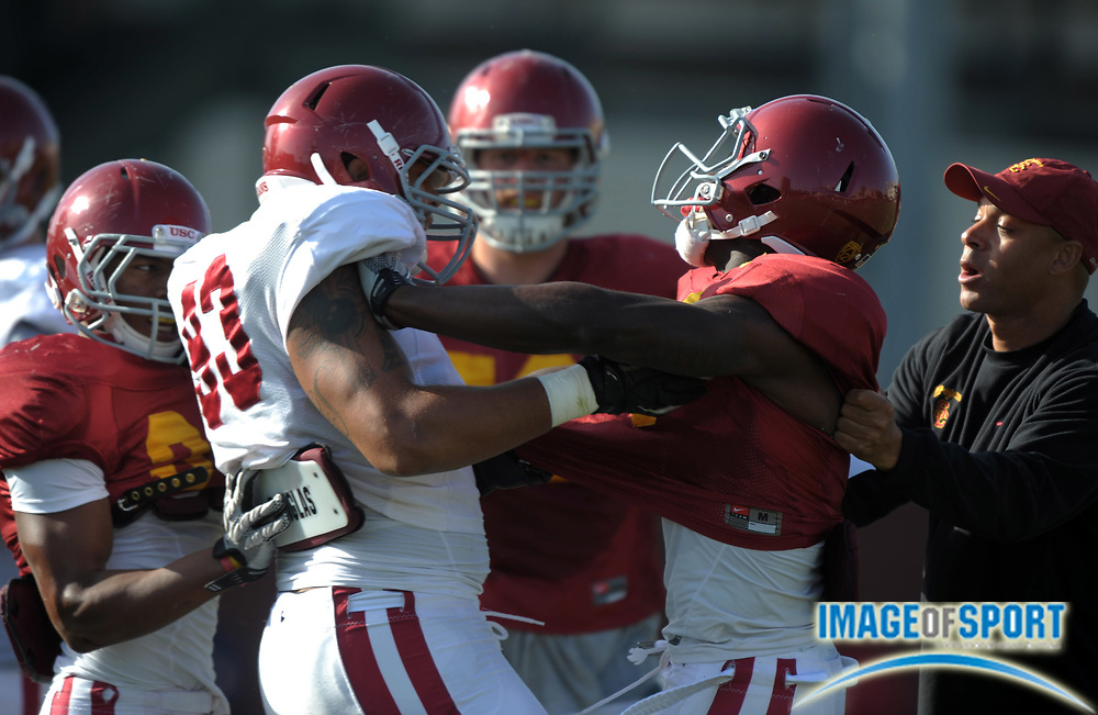 Apr 5, 2012; Los Angeles, CA, USA; Southern California Trojans defensive end Greg Townsend Jr. (93), left, and receiver Marqise Lee (9) fight at spring practice at Howard Jones Field.