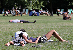 A young couple enjoy the Indian summer in Green Park, London,  Monday, 2nd September 2013. Picture by Stephen Lock / i-Images