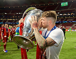 MADRID, SPAIN - SATURDAY, JUNE 1, 2019: Liverpool's Alberto Moreno kisses the trophy after the UEFA Champions League Final match between Tottenham Hotspur FC and Liverpool FC at the Estadio Metropolitano. Liverpool won 2-0 to win their sixth European Cup. (Pic by David Rawcliffe/Propaganda)