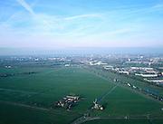 Nederland, Zuid-Holland, Grote Polder , 01-12-2005; luchtfoto (25% toeslag); de Randstad vanuit het Groene Hart, met aan de horizon in het midden Leiden en links Voorschoten; rechts autoweg N11 van Leiden naar Alphen aan de Rijn; planologie, verstedelijking, milieu, ruimtelijke ordening, landschap, landbouw (zie ook andere luchtfoto's).foto Siebe Swart