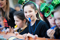 © Licensed to London News Pictures. 16/03/2014. London, UK. Children blowing whistles at the annual St Patrick's Day parade as it moves through London from Green Park to Trafalgar Square. Photo credit : David Tett/LNP