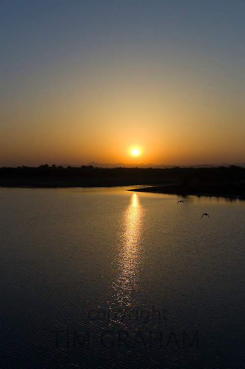 Sunrise over Aravalli Mountain Range at Chattra Sagar reservoir and bird reserve at Nimaj, Rajasthan, Northern India