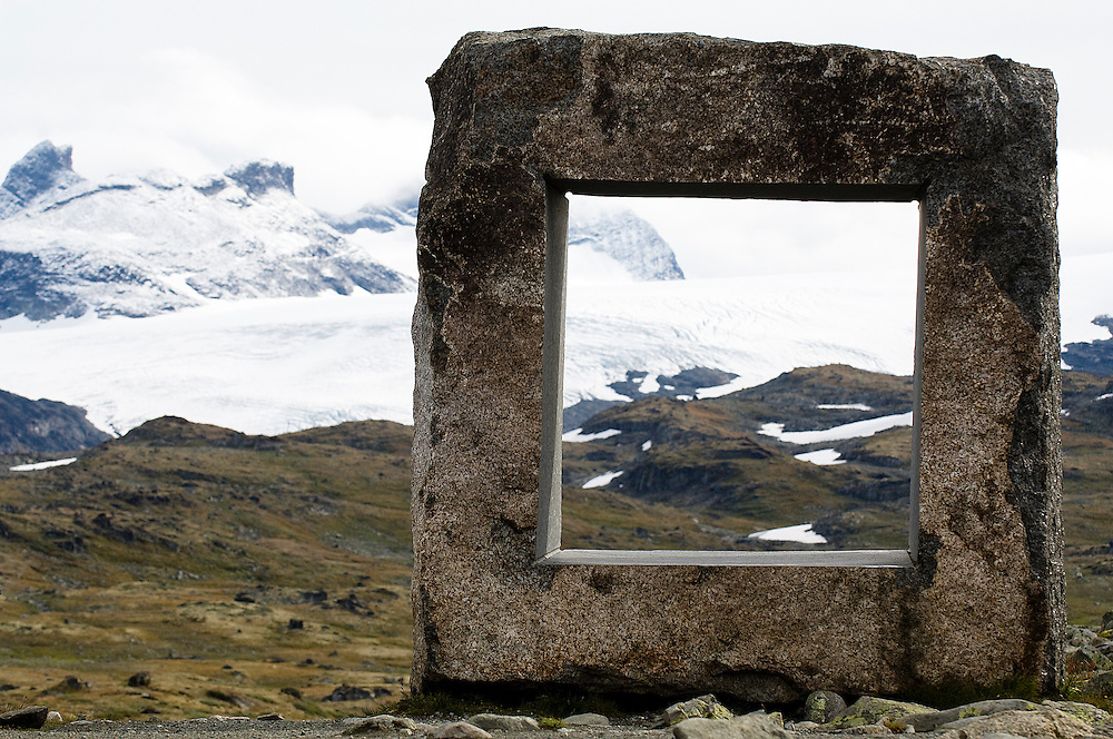 "This attraction is located at Mefjellet on Sognefjellsvegen, Norway. The stone is called the Larevikite. Locals call it 'the TV'. It cost 500000 NOR (Norwegian Krone) equal to 60000 Euros to stand on the plateau. Contemporary architecture is expressed by the Norwegian program ""The National Tourist Routes"". These projects aim to open up the stunning Norwegian landscape to tourists through a series of architectural viewpoints that enhance their surroundings."