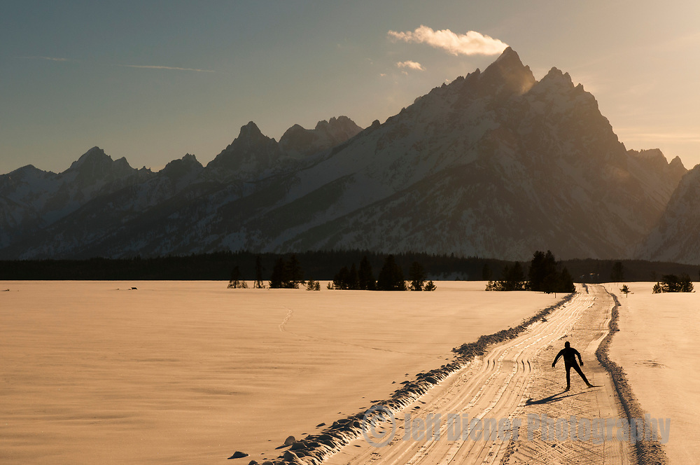 A young man nordic skate skiing in Grand Teton National Park, Jackson Hole, Wyoming.