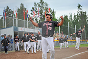 New Zealand's Wayne Laulu celebrates after touching home plate on Joel Evan's go-ahead grand slam in the sixth inning. New Zealand beat Australia in the gold medal game while Canada earned the bronze at the WBSC Men's Softball World Championship in Whitehorse July 16.