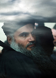 © London News Pictures. 13/11/2012. London, UK. Radical Preacher Abu Qatada arriving at his bail home in London in front of the media after being released from prison following a successful appeal against his extradition to Jordan where he was convicted of terror charges in his absence in 1999. Photo Credit: Ben Cawthra/LNP