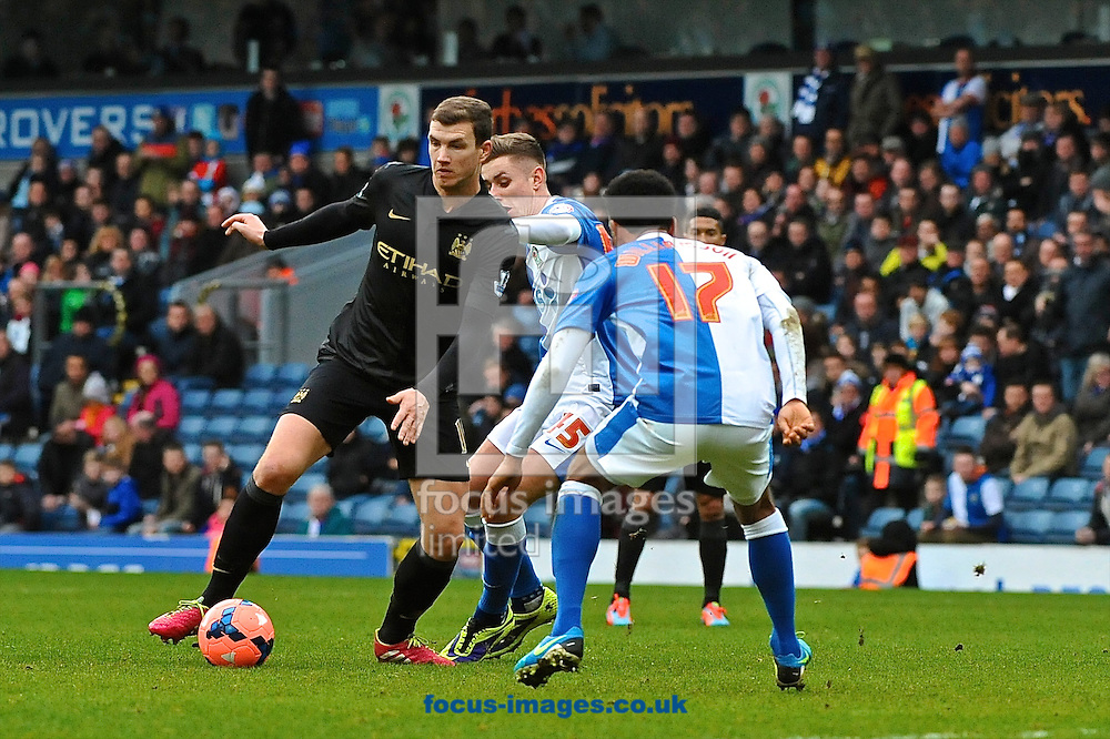 Picture by Ian Wadkins/Focus Images Ltd +44 7877 568959<br /> 04/01/2014<br /> Edin Džeko of Manchester City takes on Tom Cairney and Lee Williamson of Blackburn Rovers during the The FA Cup match at Ewood Park, Blackburn.