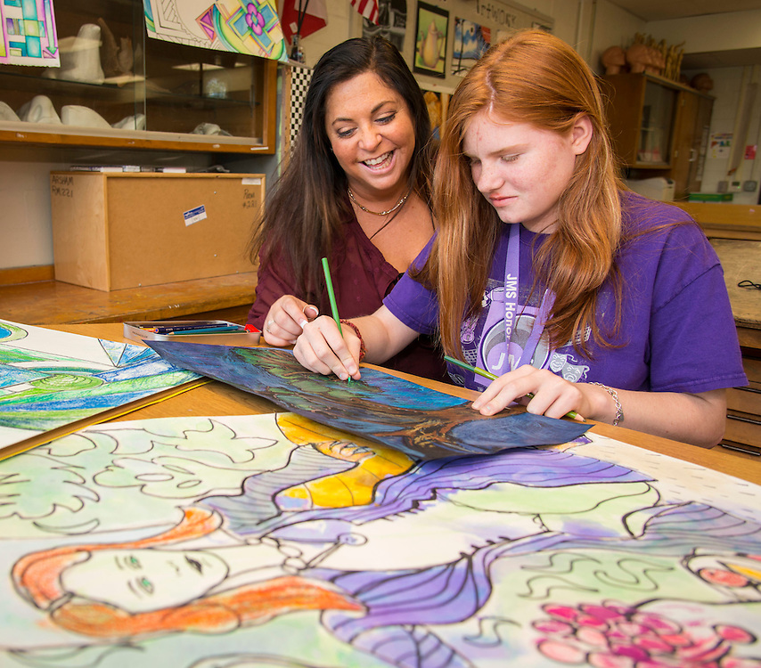 Johnston Middle School art teacher Tobi Arsham works with 7th grader Makaila Maniscalco on her art work, April 22, 2015.