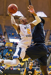 Nov 20, 2016; Morgantown, WV, USA; West Virginia Mountaineers guard Jevon Carter (2) shoots while contested by New Hampshire Wildcats forward Iba Camara (12) during the second half at WVU Coliseum. Mandatory Credit: Ben Queen-USA TODAY Sports