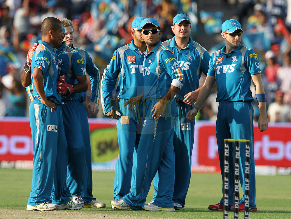 Pune Warriors players celebrate after wicket during match 31 of the Indian Premier League ( IPL) 2012  between The Pune Warriors India and the Delhi Daredevils held at the Subrata Roy Sahara Stadium, Pune on the 24th April 2012..Photo by Vipin Pawar/IPL/SPORTZPICS
