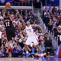 12 February 2014: Portland Trail Blazers power forward LaMarcus Aldridge (12) takes a jumpshot over Los Angeles Clippers center DeAndre Jordan (6) during the Los Angeles Clippers 122-117 victory over the Portland Trail Blazers at the Staples Center, Los Angeles, California, USA.