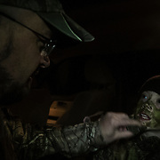 Brett Ladeau, 44, of Hartland, left, paints his daughter Sydney Ladeau's face with camouflage around 4:30 a.m. before exiting the truck for the woods on youth turkey opener on April 28, 2012.
