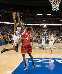 Virginia Cavaliers point guard Sean Singletary (44) is fouled by North Carolina State Wolfpack guard Courtney Fells (4) on his way to the basket.  The Virginia Cavaliers Men's Basketball Team fell to the North Carolina State Wolfpack 76-71 in the quarterfinal round of the 54th ACC Tournament at the St. Pete's Times Forum in Tampa, FL on March 9, 2007.