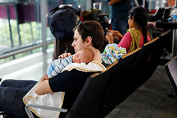 © Licensed to London News Pictures. 29/05/2017. London, UK. A new born baby passenger and parents wait for their flights on bank holiday Monday after a major British Airways IT crash causing further problems in Heathrow Terminal 5 since Saturday. Photo credit: Tolga Akmen/LNP