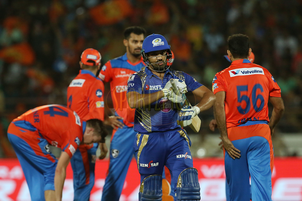 Mumbai Indians captain Rohit Sharma walks back to the pavilion after getting outduring match 35 of the Vivo 2017 Indian Premier League between the Gujarat Lions and the Mumbai Indians  held at the Saurashtra Cricket Association Stadium in Rajkot, India on the 29th April 2017<br /> <br /> Photo by Vipin Pawar - Sportzpics - IPL
