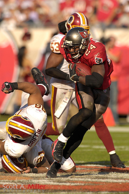 Nov. 19, 2006; Tampa, FL, USA;  Tampa Bay Buccaneers running back (24) Carnell Williams heads up field during the second half of the Bucs 20-17 win over the Washington Redskins at Raymond James Stadium. ...©2006 Scott A. Miller